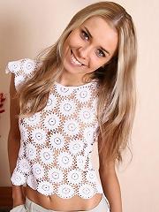 Sexy blonde looks cute in her white panties