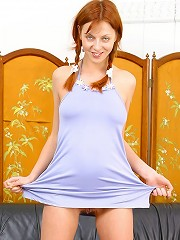 Redhead massaging her horny body