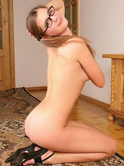 Sweet girl with glasses posing in teeny outfit